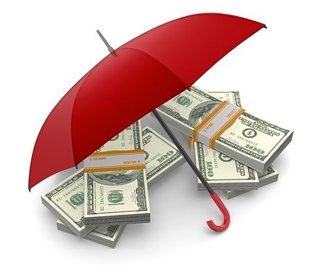 Introduction to Derivatives - The basics of hedging; picture of an umbrella covering and protecting a pile of investors money from the risk by hedging the funds