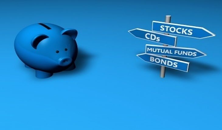 An Overview of Investing - The Reluctance to Invest; Picture of investment options for stock investors saying stocks mutual funds and bonds with a blue piggy bank beside it.