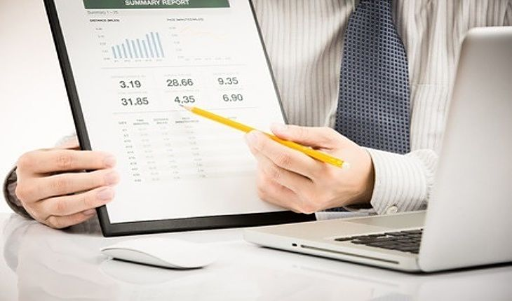 An Overview of Investing Strategies - Value Investing; Picture of a stock Investor holding a clipboard and pointing with a pencil showing the value investment returns he achieved from the stock market.