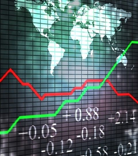 An Overview of Investing Strategies - International Investing; Picture of an International stock Investing chart with global returns shown on a large wall mounted chart with price data shown on the bottom.