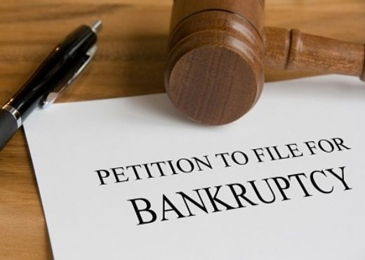 Bankruptcy of Listed Companies; picture of a sheets of paper with legal document for the petition to file for bankruptcy for a company in a court room
