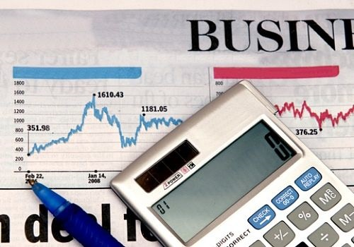 Profits and the Economy - Business Cycles; picture the stock market index chart in a newspaper with a business calculator on top of the page for stock prices analysis