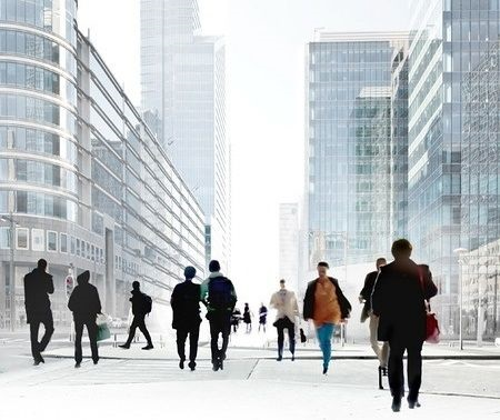 Stock Market Business Basics - Business Types; picture of a group of business men walking in the city with office buildings in the background