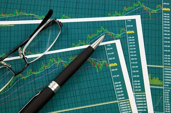 Swing Trading - Creating the List; picture of three stock trading charts layered on top of each other to select stocks to trade for investors to make their selection easier