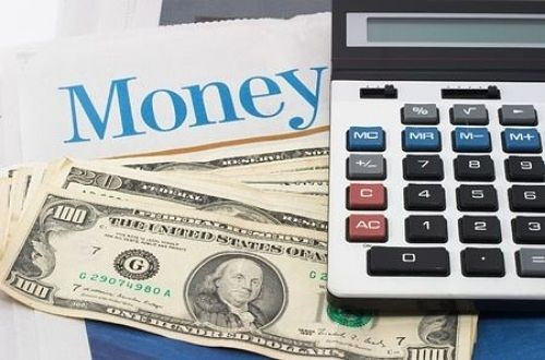 Contrarian Investing - Do not Play the Market; picture of calculator on top of a pile of money with writing saying money in large blue letters as a sign