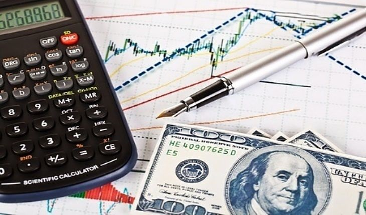 Stock Market Theories - Elliott Wave Theory; picture of a stock chart printed out on paper showing technical analysis using Elliot waves with a calculator on top with money depicting profitable trade