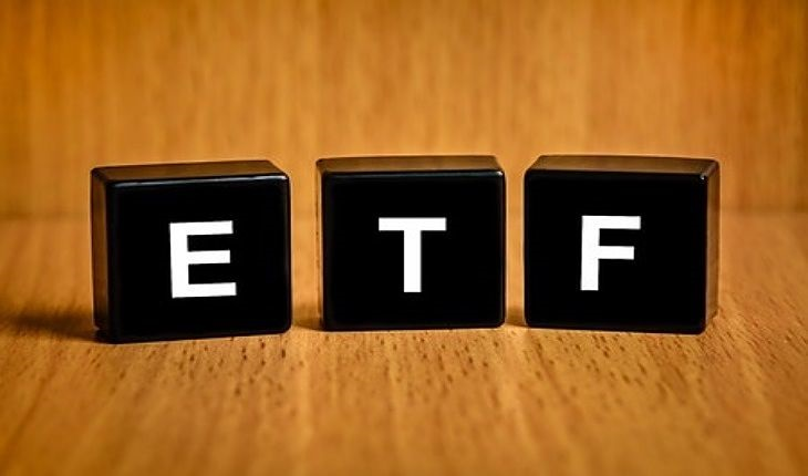 Sectors and industries Investing with Funds - picture of three black blocks with large white capital letters that spell ETF for investors to build their fund portfolio
