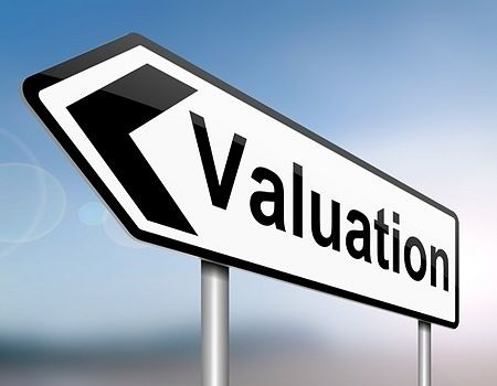 Stock Market Business - Fundamental Valuation; picture of a road sign with two posts with the word valuation written on it in black capital letters with an arrow pointing forwards