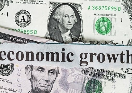 Profits and the Economy - GDP and the Stock Market; picture of the United States of America dollar bill money with writing across saying economic growth for gross domestic product
