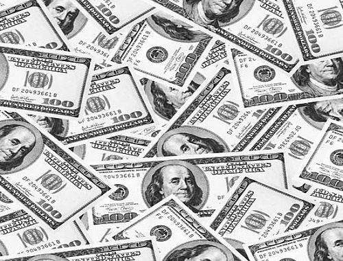 Profits and the Economy - GDP and the Stock Market: picture of lots of United States of America one hundred dollar bills in a big pile for the stock market