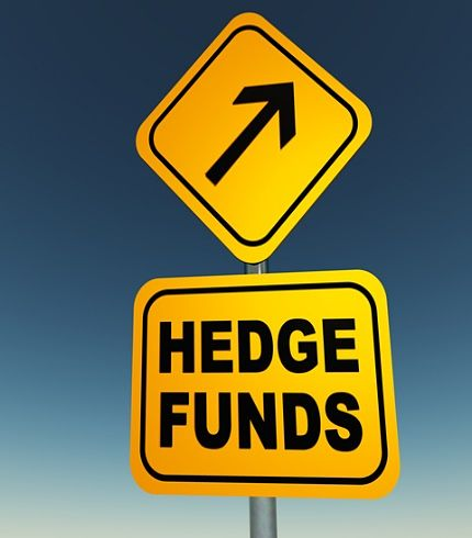 The Investing Style of George Soros; Picture of a road sign with yellow background with black letters saying hedge fund sign. George Soros managed several hedge funds.