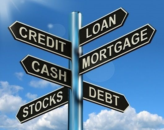 Investing on Margin - How Stock Margin Works; picture of a sign post with six different signs saying credit loan stocks cash debt and mortgage