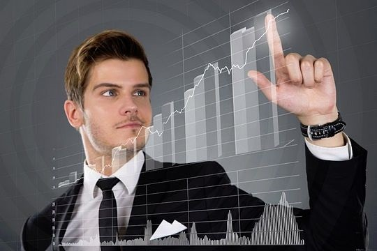 Fundamental Analysis - Industry Based Ratio Analysis; picture of an investor checking earnings trend on a stock chart for growth