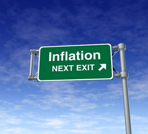 Stock Market Theories - Inflation and PE Ratios; picture of an overhead road sign with green background with large white writing on it saying inflation next exit