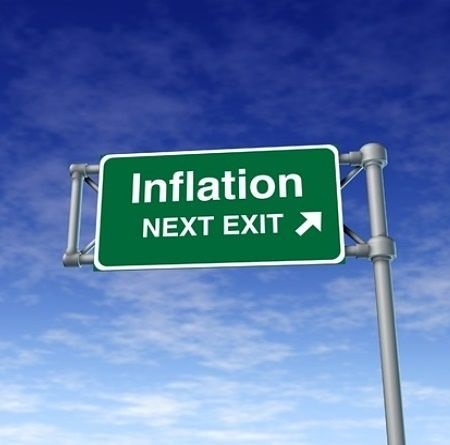 Profits and the Economy - Inflation and the Stock Market; picture of an overhead road sign with a green background with writing on it saying inflation next exit for stock market