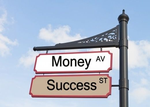 The Investing Style of Benjamin Graham - Intelligent Investing Strategies; Picture of a street sign with white background and black letters for stock investors showing money and success.