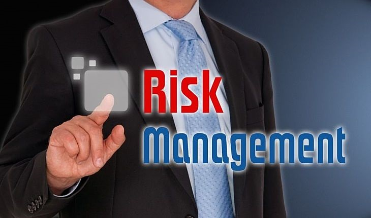 Risk Analysis - Introduction - picture of risk analysis also known as risk management with investor pointing at risk sign in large capital letters on a glass panel