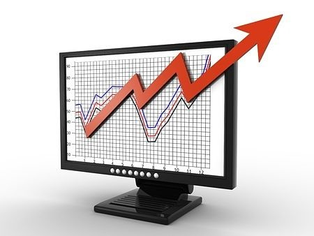 Position Trader - Building a Position Trading List; picture of an animated stock chart with increasing prices displayed on a computer with an arrow coming out of the screen