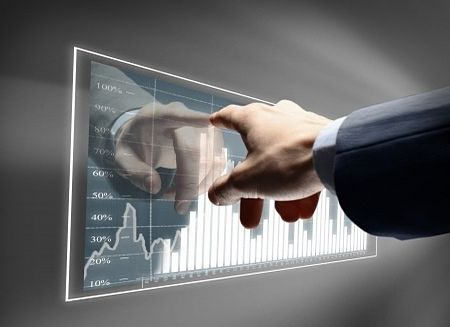 The Investing Style of William O'Neil - The Life of William O'Neil; Picture of a stock chart on a wall mounted glass panel with earnings growth with a stock investor point to it with his finger.