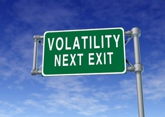 Understanding Stock Options - Option Behavior and the Greeks; picture of an overhead road sign stating that volatility is at next exit for the Greeks