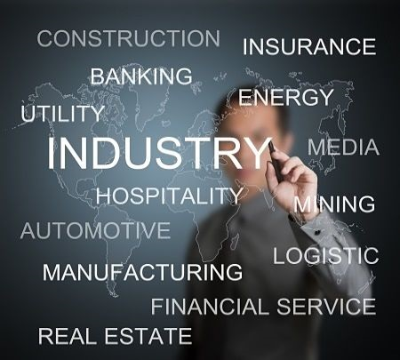 Risk Analysis - Portfolio Diversification; picture of an investor pointing at a sign with a black background with various industries written on it in white font