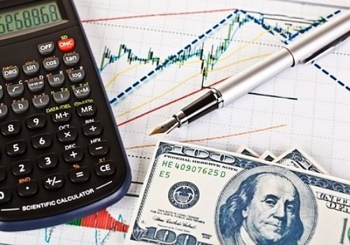 Position Trading - picture of a position trader with his tactics using technical analysis for trends with a calculator and money on a stock chart
