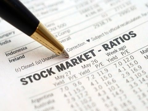 Fundamental Analysis - Price Earnings Based Ratios; picture of a pen pointing to stock market ratios on a financial newspaper for stock marker data