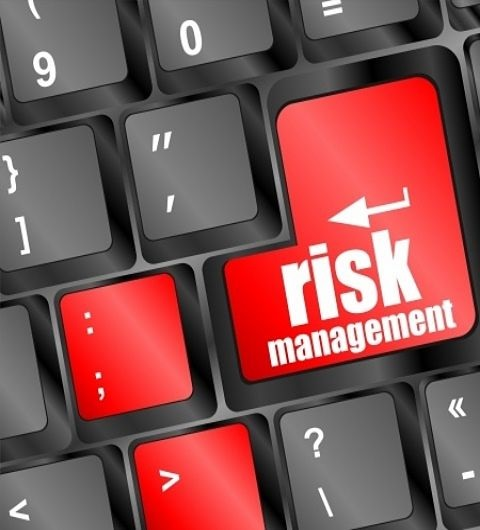 Risk Analysis - picture of risk management wording printed on a black keyboard with keys in large scale red font on computer