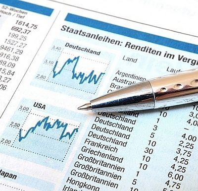 Selecting a stock Fund - picture of a financial newspaper with stock charts and price data to assist investors to select a fund
