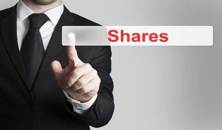 Short Selling Strategies - Short Interest; picture of an investor pointing to glass see through sign button on the screen saying shares in big red letters
