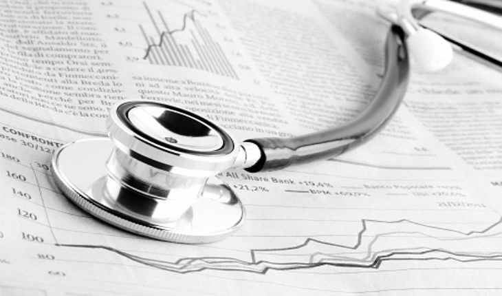 Short Selling Strategies - Short Selling Distressed Stocks; picture of a financially unhealthy stock with a medical scope on the stock report indicating that the company should be sold by investors