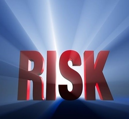 Speculative Investing Strategies - Small-Cap Growth Stocks; picture of a ythree dimensional sign saying risk in big red capital letters on a light blue background
