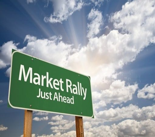 Stock Investing Part 1 - Stock Market Cycles; Picture of a road sign board with green background and large white capital letters showing market rally ahead for stock investing.