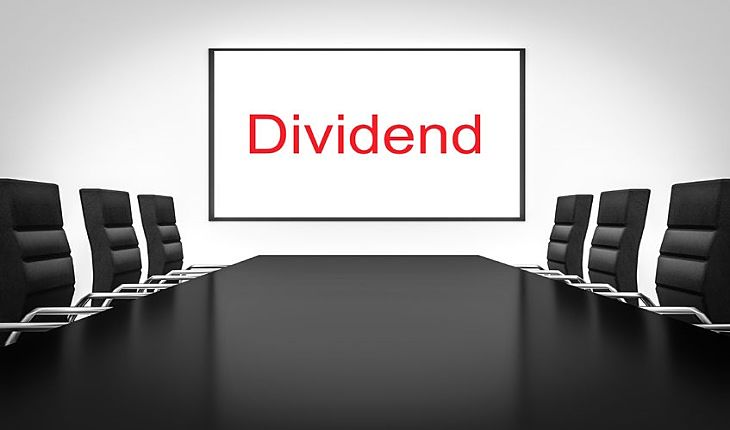 Stock Investing Part 1 - Stock Dividends; Picture of a company board room for stock investing with a large black conference table with six black leather chairs signifying strong dividends .