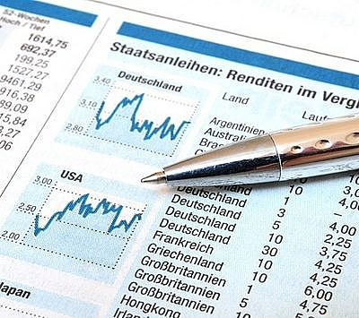 An Overview of Investing Strategies - International Investing; Picture of an International stock Investment returns data shown next to charts and tables with a blue boarder.