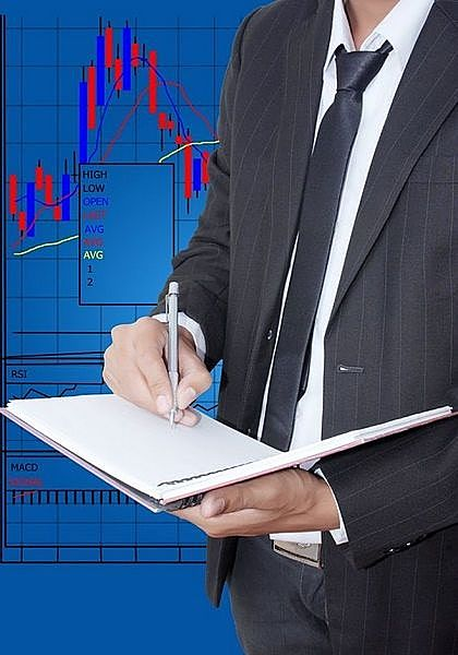 trade management Stock Order Attributes - picture of a stock trader analyzing a chart to place an order with attributes to manage a position