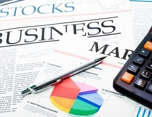 Investing in Stocks for Beginners - stock repurchases picture of a financial newspaper with the business section and a pie chart printed on paper next to a calculator