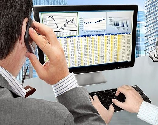 Risk Analysis - Stock Risk Control Tactics; picture of an investor assisting a man who is checking risk on a computer with stock data and charts shown on the screen