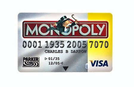 Stock Market Business Basics - The Consumer Monopoly; picture of a consumer visa credit card for investors with the word monopoly written on the front in large scale capital letters