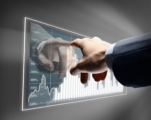Growth Investing - The Growth Investor; picture of investor hand pointing at chart on a glass panel against a grey wall