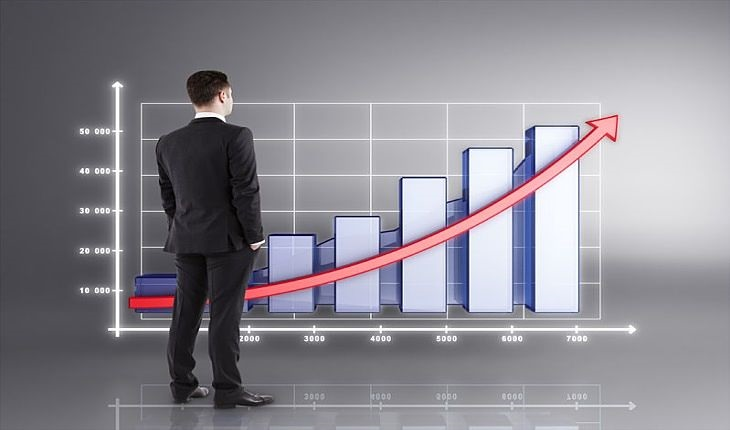 Growth Investing - The Growth Investor; picture of growth investing chart with grey background with man in suit examining the trend