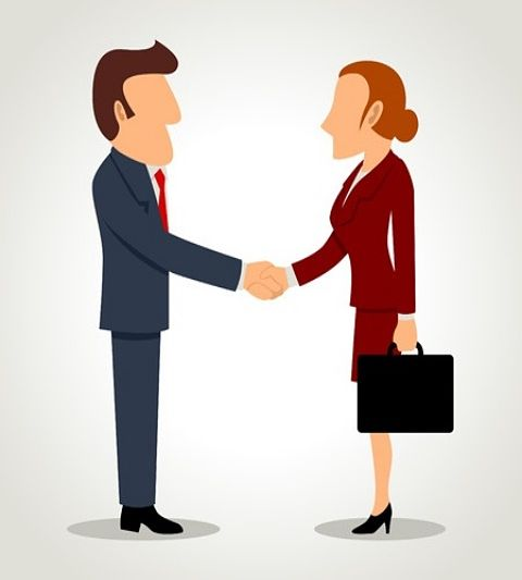The Investing Style of Benjamin Graham - Picture of two animated business people shaking hands. Benjamin Graham liked to look for Acquisitions in his investing style.