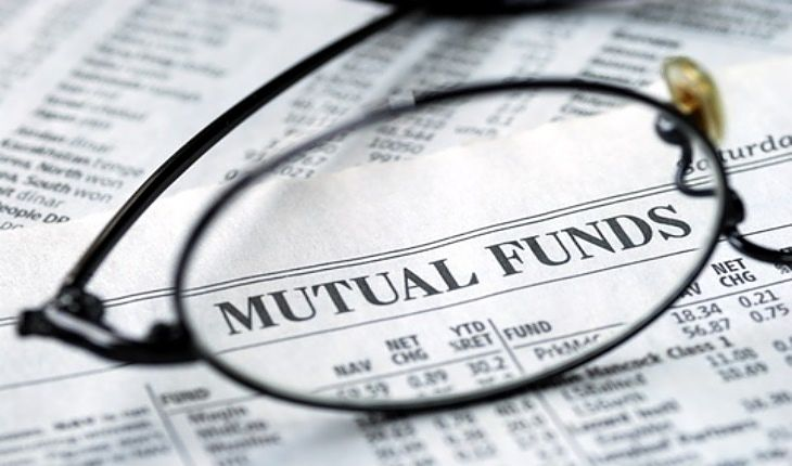 The Investing Style of Peter Lynch; Picture of a financial newspaper showing mutual funds table for stock investors to buy and sell to build up their funds investment portfolio.