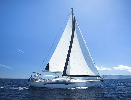 The Investing Style of Jesse Livermore - The Life of Jesse Livermore; Picture of a wealthy stock investors large luxury yacht sailing on the open ocean waters on a clear blue sky day.