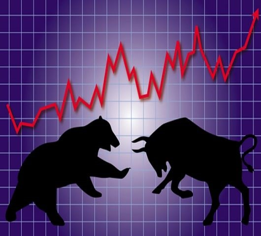 Stock Market Theories - The Principle of Supply and Demand; picture of a stock chart on a wall panel with a bull and a bear animals going into a head to head battle