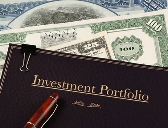 Stock Investing Part 2 - Building an Investment Portfolio; Picture of an Investment Portfolio in  a brown leather covered folder showing all the money made by the stock investor.