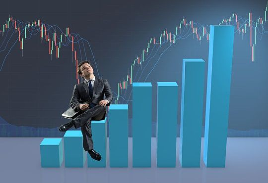 How to Invest in Stocks - Understanding Market Cycles; Picture of a beginner stock investor sitting down while looking at the Market Cycles located on a large graph.