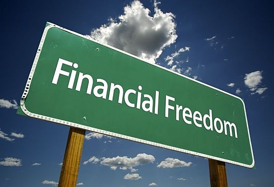 Investing in Stocks for Beginners - picture of a road sign with green background and large white capital letters say financial freedom why investing is important for the future