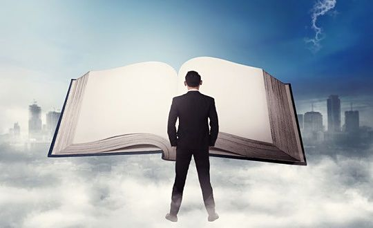 Investing in Stocks for Beginners - words of wisdom; picture of a stock investor standing in front of a very large book and reading the knowledge contained within